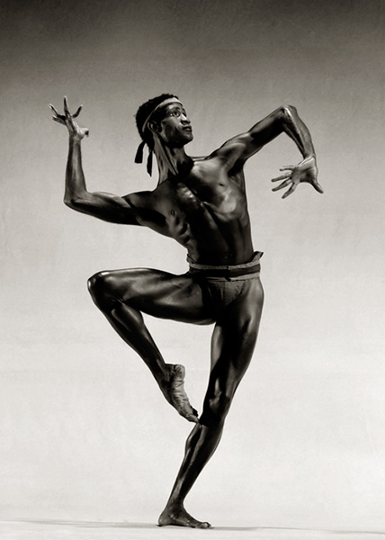 Strong and handsome dancer Mel Tomlinson holding a passé position.