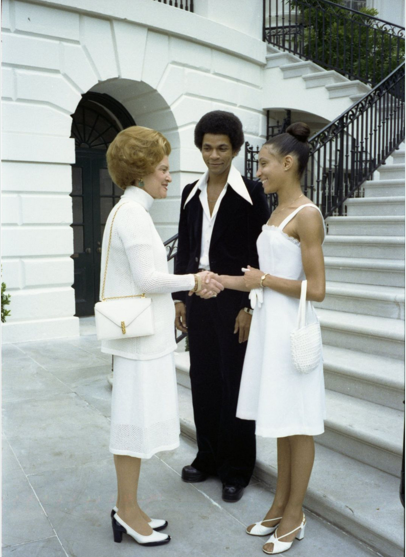 First Lady Betty Ford greeting ballet dancer Sandra Fortune-Green and Sylvester Campbell at the White House, 6/29/1976 (White House Photograph B0404-03A)